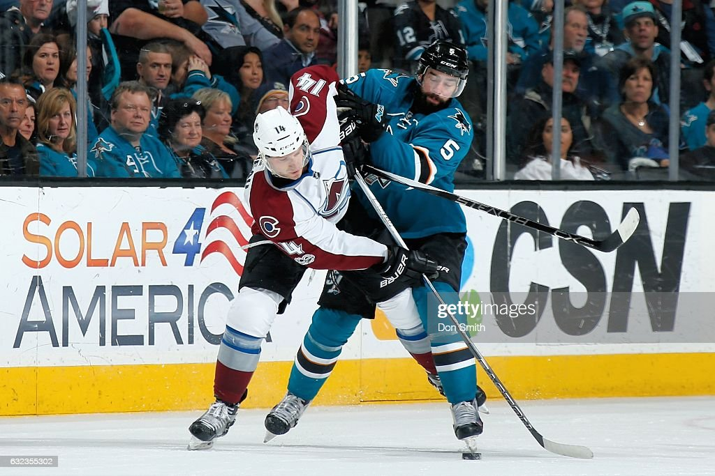 David Schlemko #5 of the San Jose Sharks and Blake Comeau #14 of the Colorado Avalanche battle for the puck at SAP Center at San Jose on January 21, 2017 in San Jose, California.