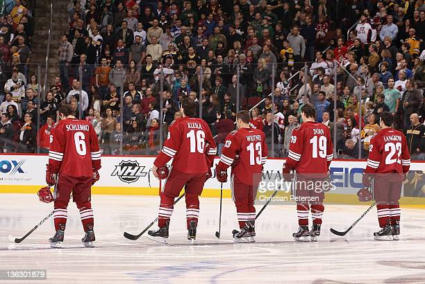 David Schlemko Rostislav Klesla Ray Whitney Shane Doan and Daymond Langkow of the Phoenix Coyotes stand attended for the National Anthem before the...