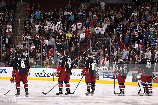 David Schlemko Rostislav Klesla Shane Doan Ray Whitney and goaltender Mike Smith of the Phoenix Coyotes stand attened for the National Anthem before...