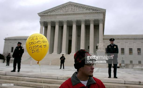 David Schuster of St Louis MO holds a balloon that reads Prochoice is a lie Babies don't choose to die in front of the Supreme Court during the March...