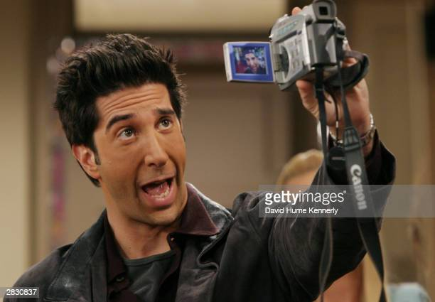 "David Schwimmer, who plays Ross on the hit NBC series ""Friends,"" performs during one of their last shows on the Warner Bros lot Sept. 12, 2003 in..."