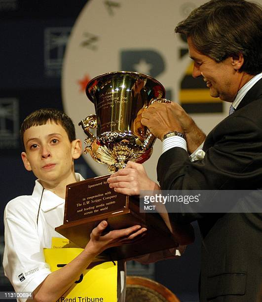 WASHINGTON DC David Scott Tidmarsh from South Bend Indiana holds up his trophy after he won the 77th National Spelling Bee on Thursday June 3 in...
