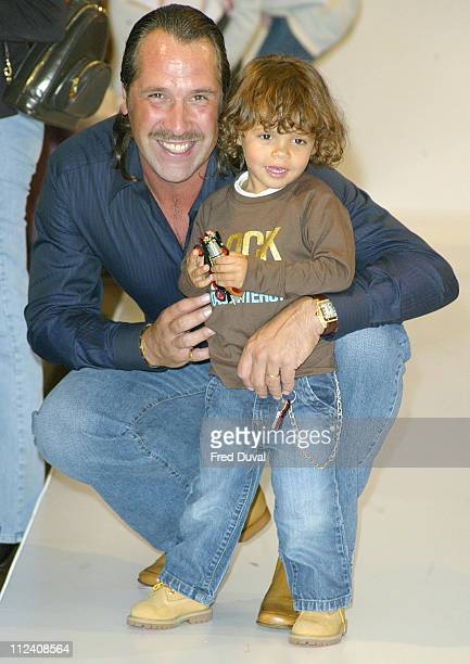 David Seaman and child during Dolce Gabbana Children's Fashion Show in Association with Vogue Bambini and Barnado's at Harrod's in London Great...