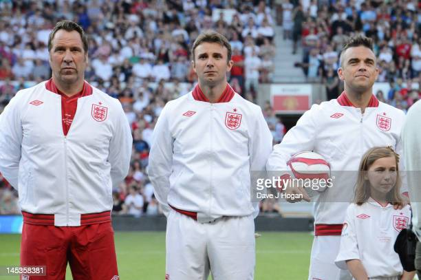 David Seaman, Jonathan Wilkes and Robbie Williams attend Soccer Aid 2012 in aid of Unicef at Old Trafford on May 27, 2012 in Manchester, England.