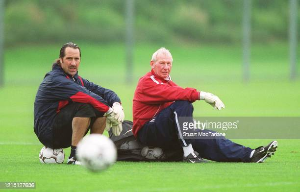 David Seaman of Arsenal and Bob Wilson Arsenal Goalkeeping Coach during an Arsenal Training Session at Arsenal Training Ground on October 21 2002 in...