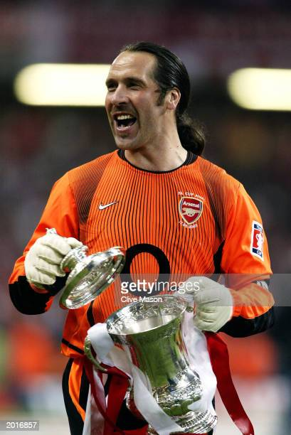 David Seaman of Arsenal celebrates with the FA Cup after winning the FA Cup Final match between Arsenal and Southampton on May 17 2003 at the...