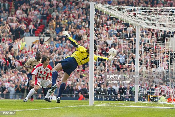 David Seaman of Arsenal makes a spectacular save to keep the ball out during the FA Cup Semi-Final match between Arsenal and Sheffield United held on...