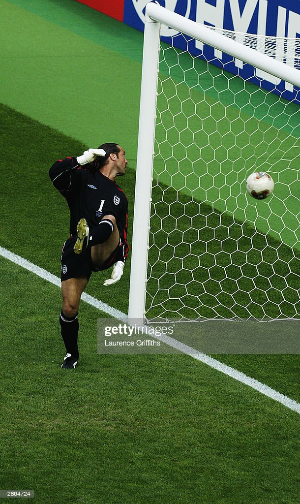 David Seaman of England is caught off his line as Ronaldinho scores Brazil's second goal during the England v Brazil World Cup Quarter Final match played at the Shizuoka Stadium Ecopa in Shizuoka, Japan on June 21, 2002. David Seaman, who was capped 75 times for England, announced his decision to retire January 13, 2004 due to a long-term shoulder injury.