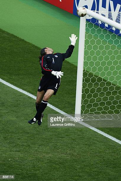 David Seaman of England is caught off his line as Ronaldinho scores Brazil's second goal during the England v Brazil World Cup Quarter Final match...