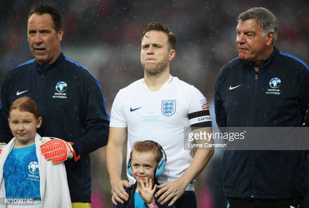 David Seaman of England Olly Murs of England and Sam Allardyce manager of England look on prior to the Soccer Aid for UNICEF 2018 match between...