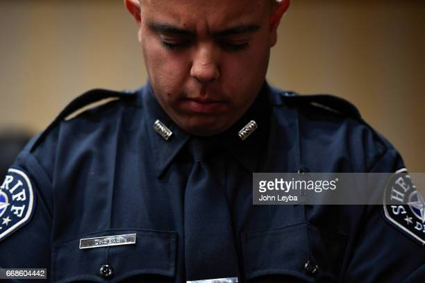 David Seas stands at attention during the invocation by Chaplain Gary Rolando The Denver Sheriff Academy held its Academy Class of 20163 on April 14...