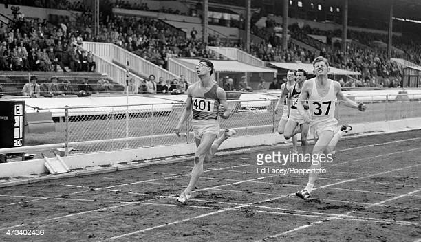 David Segal and Robbie Brightwell of Great Britain cross the finish line of the 440 yards dash during an Inter Counties event at the White City...