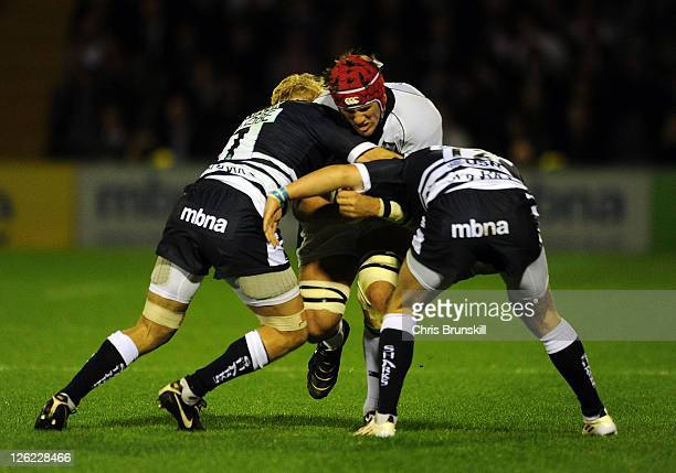 David Seymour and Will Addison of Sale Sharks tackle Christian Day of Northampton Saints during the AVIVA Premiership match between Sale Sharks and...