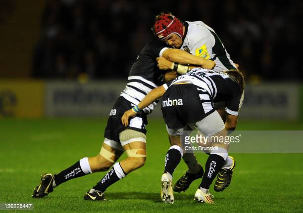 David Seymour and Will Addison of Sale Sharks tackles Christian Day of Northampton Saints during the AVIVA Premiership match between Sale Sharks and...