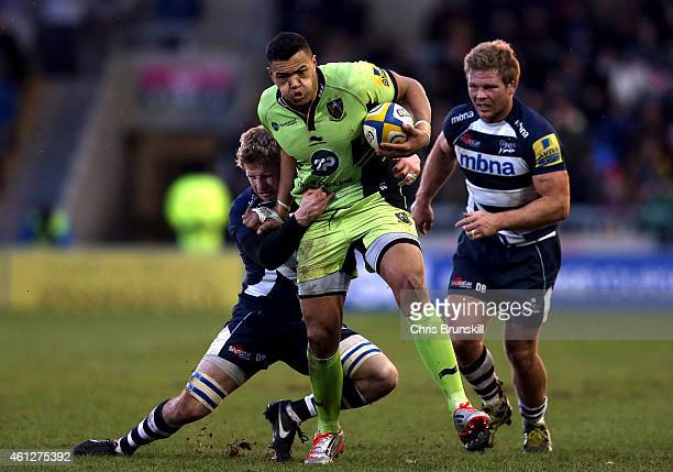 David Seymour of Sale Sharks tackles Luther Burrell of Northampton Saints during the Aviva Premiership match between Sale Sharks and Northampton...