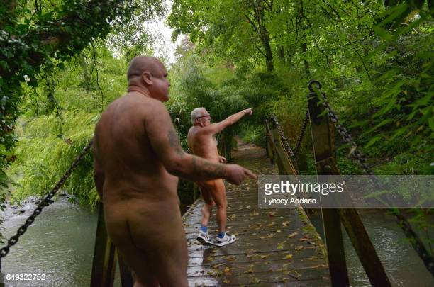 David Shelly and Barry Graanop walk along with other naturists on Clothes Optional Day in the Abbey House Gardens in Malmesbury England Sept 23 2012...