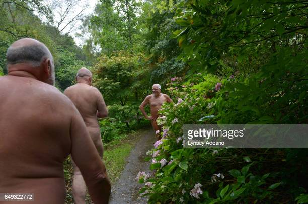 David Shelly Ron Law and Barry Graanop walk along with other naturists on Clothes Optional Day in the Abbey House Gardens in Malmesbury England Sept...