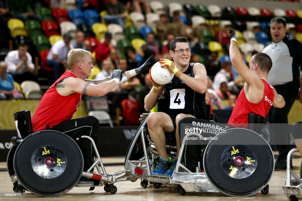 David Sherriff of New Zealand passes the ball during the Wheelchair Rugby match between Denmark and New Zealand during Day Two of the Invictus Games at the Olympic Park on September 12, 2014 in London, England.