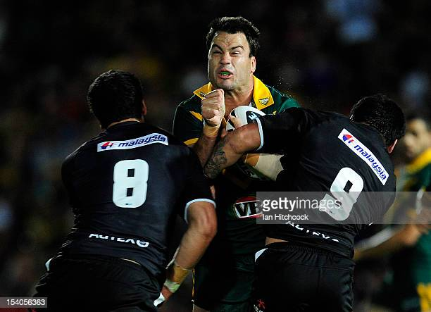 David Shillington of the Kangaroos is tackled by Isaac Luke and Jesse Bromwich of the Kiwis during the International Test match between the...