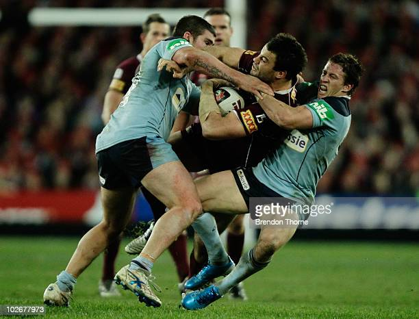 David Shillington of the Maroons is tackled by the Blues defence during game three of the ARL State of Origin series between the New South Wales...