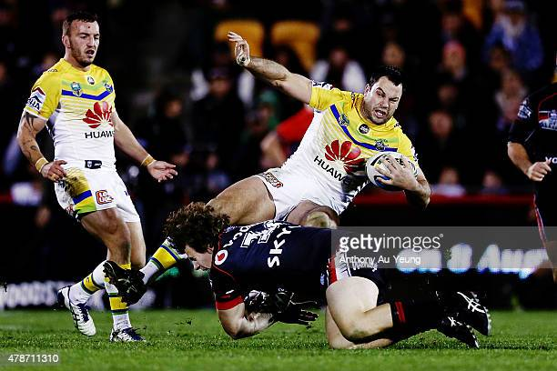 David Shillington of the Raiders is tackled by Charlie Gubb of the Warriors during the round 16 NRL match between the New Zealand Warriors and the...