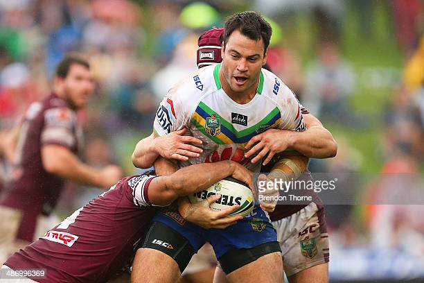 David Shillington of the Raiders is tackled by the Sea Eagles defence during the round 8 NRL match between the Manly-Warringah Sea Eagles and the...