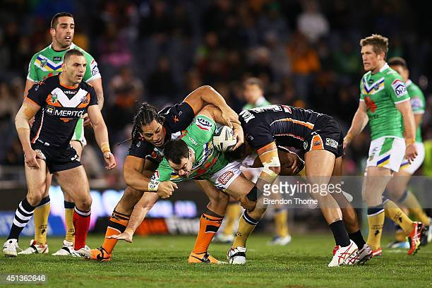 David Shillington of the Raiders is tackled by the Tigers defence during the round 16 NRL match between the Wests Tigers and the Canberra Raiders at...