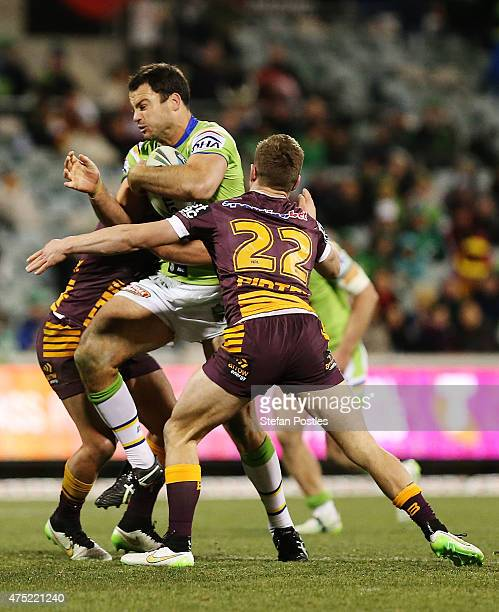 David Shillington of the Raiders is tackled during the round 12 NRL match between the Canberra Raiders and the Brisbane Broncos at GIO Stadium on May...