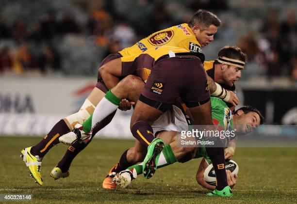 David Shillington of the Raiders is tackled during the round 13 NRL match between the Canberra Raiders and the Brisbane Broncos at GIO Stadium on...