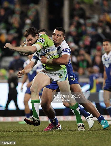 David Shillington of the Raiders is tackled during the round 15 NRL match between the Canberra Raiders and the CanterburyBankstown Bulldogs at GIO...