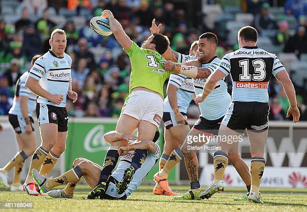 David Shillington of the Raiders off loads during the round 19 NRL match between the Canberra Raiders and the Cronulla Sharks at GIO Stadium on July...