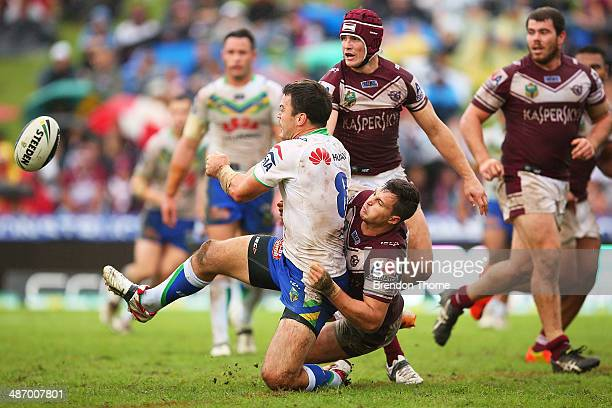 David Shillington of the Raiders offloads the ball to a team mate during the round 8 NRL match between the Manly-Warringah Sea Eagles and the...