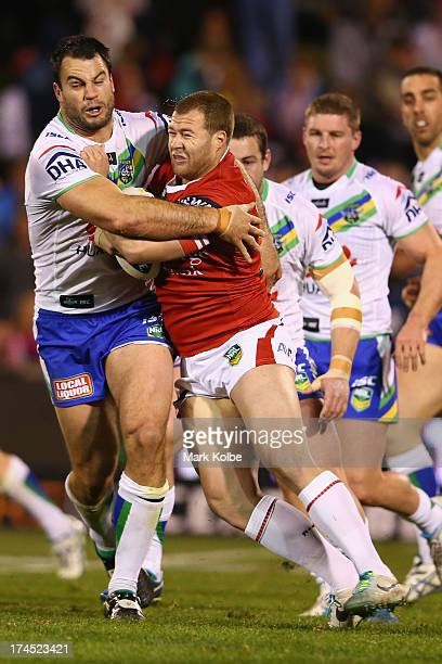 David Shillington of the Raiders tackles Trent Merrin of the Dragons during the round 20 match between the St George Illawarra Dragons and the...