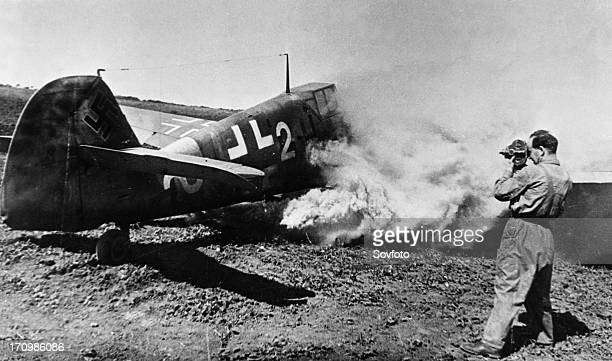 David sholomovich cameraman and major in the soviet aviation forces filming a burning messerschmitt mb41 shot down by soviet flying ace captain...