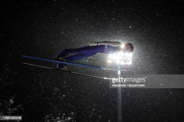 David Siegel of Germany competes during the first round on day 8 of the 67th FIS Nordic World Cup Four Hills Tournament ski jumping event at...