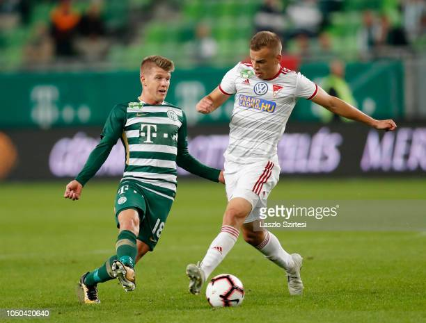 David Siger of Ferencvarosi TC competes for the ball with Attila Haris of DVSC during the Hungarian OTP Bank Liga match between Ferencvarosi TC and...