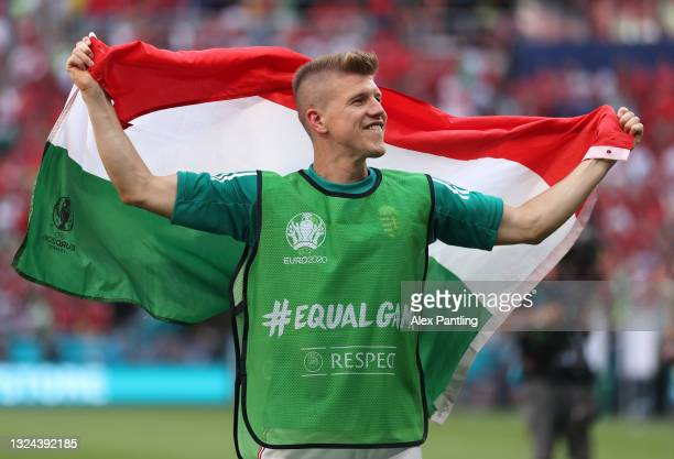 David Siger of Hungary celebrates with a flag following the UEFA Euro 2020 Championship Group F match between Hungary and France at Puskas Arena on...