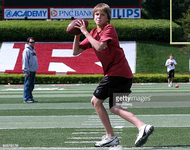 David Sills of Bear, Delaware, foreground, throws a pass as his father David looks on at left, while attending Air 7 Quarterback University at...