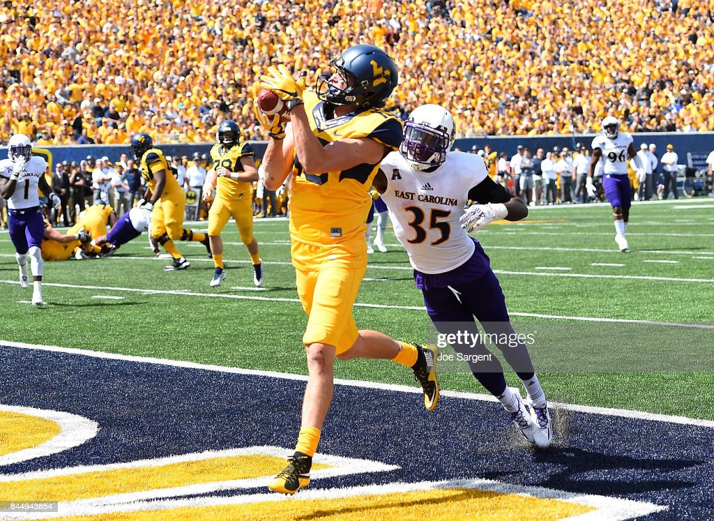 David Sills V #13 of the West Virginia Mountaineers makes a touchdown catch in front of Chris Love #35 of the East Carolina Pirates during the second quarter at Mountaineer Field on September 9, 2017 in Morgantown, West Virginia.