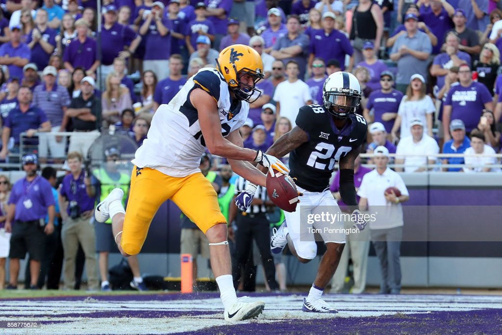 David Sills V #13 of the West Virginia Mountaineers pulls in a pass for a touchdown against Tony James #28 of the TCU Horned Frogs in the second half at Amon G. Carter Stadium on October 7, 2017 in Fort Worth, Texas.