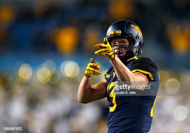 David Sills V of the West Virginia Mountaineers reacts after a first down in the first half against the Baylor Bears at Mountaineer Field on October...