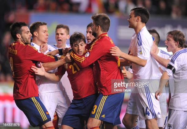 David Silva , Alvaro Negredo and Gerard Pique of Spain tussle with finnish players during the FIFA 2014 World Cup Qualifier between Spain and Finland...