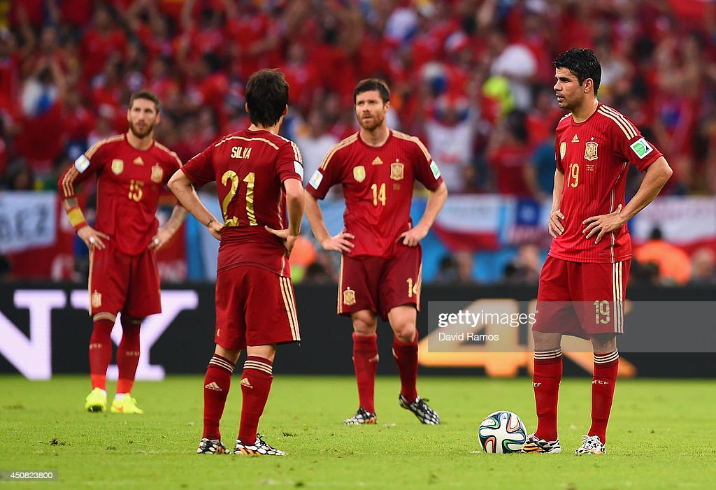 David Silva (2nd L) and Diego Costa of Spain (R) wait to kickoff after allowing Chile's second goal during the 2014 FIFA World Cup Brazil Group B match between Spain and Chile at Maracana on June 18, 2014 in Rio de Janeiro, Brazil.