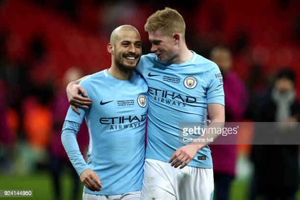 David Silva and Kevin De Bruyne of Manchester City celebrate after the Carabao Cup Final between Arsenal and Manchester City at Wembley Stadium on...