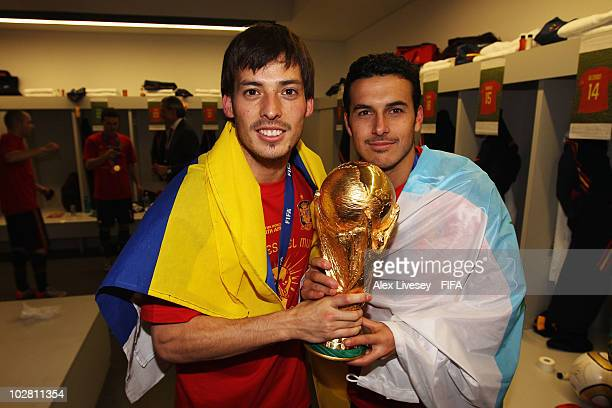 David Silva and Pedro Rodriguez of Spain pose with the trophy in the Spanish dressing room after they won the 2010 FIFA World Cup at Soccer City...