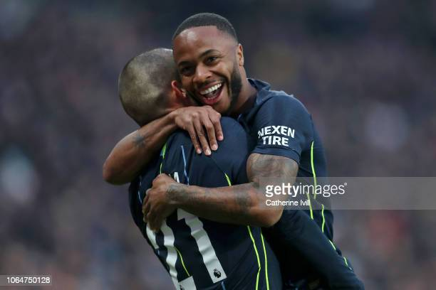 David Silva celebrates after scoring his team's first goal with teammate Raheem Sterling during the Premier League match between West Ham United and...