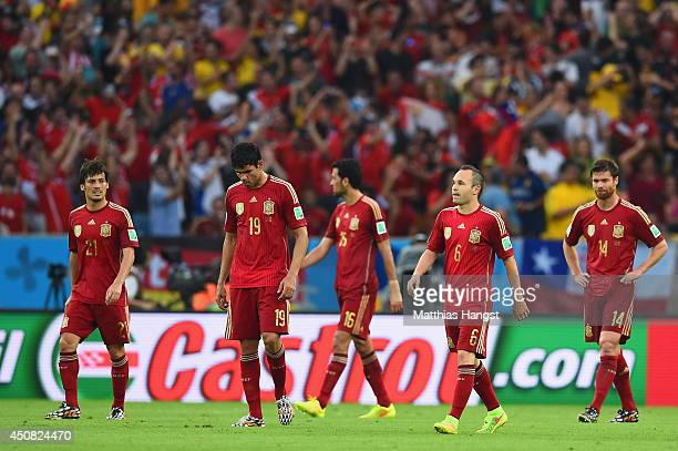 David Silva Diego Costa Sergio Busquets Andres Iniesta and Xabi Alonso of Spain look on during the 2014 FIFA World Cup Brazil Group B match between...