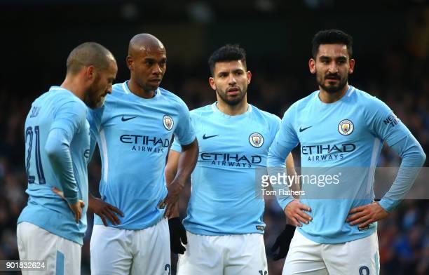 David Silva Fernandinho Sergio Aguero and Bernardo Silva of Manchester City during the The Emirates FA Cup Third Round match between Manchester City...