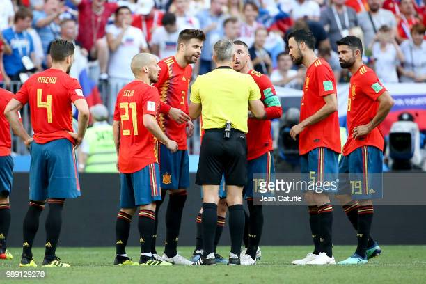 David Silva Gerard Pique Sergio Ramos Sergio Busquets Diego Costa of Spain argue for the penalty with referee Bjorn Kuipers of the Netherlands during...