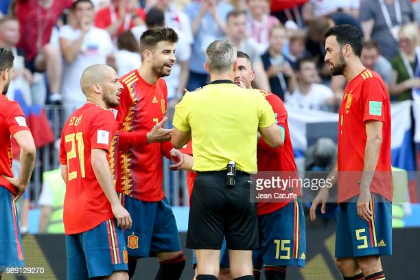 David Silva Gerard Pique Sergio Ramos Sergio Busquets of Spain argue for the penalty with referee Bjorn Kuipers of the Netherlands during the 2018...
